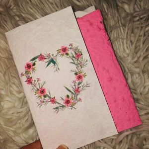 Pink paper containing wild flower seeds